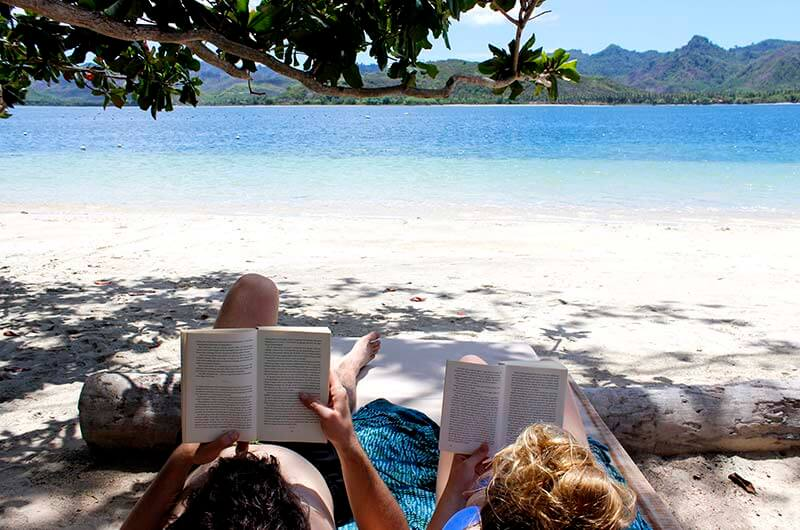 Gili Asahan Reading on the beach Lombok